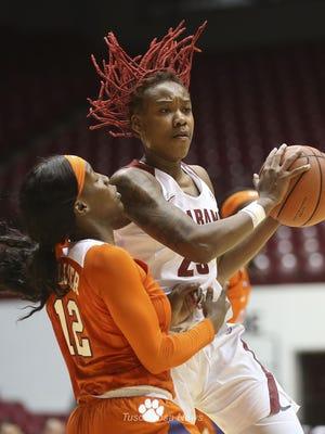 Clemson guard Aliyah Collier (12) defends Alabama guard Shaquera Wade (23) as she makes a pass in Coleman Coliseum Monday, Nov. 19, 2018.
