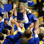 Graduates throw their caps after the Sumrall High School graduation ceremony held at the Reed Green Coliseum Saturday.