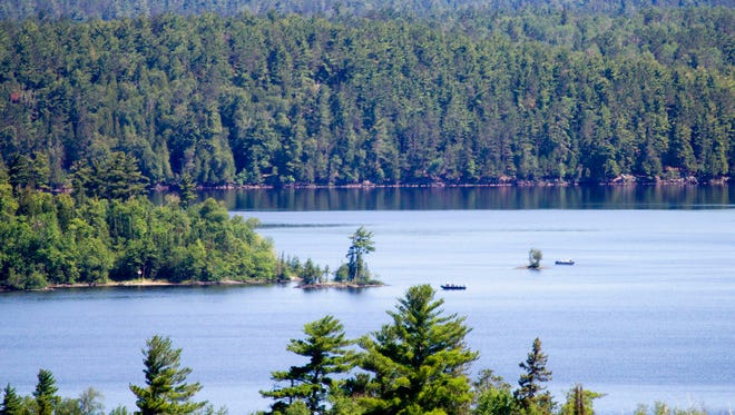 This June 30, 2010 file photo shows boaters  on Lake Vermilion from one of Lake Vermilion State Park's highest hills near Soudan, Minn. Officials are hoping to open the much-anticipated campground at Lake Vermilion-Soudan Underground Mine State Park, the newest gem in Minnesota's state park system in September 2017 after construction delays got in the way.