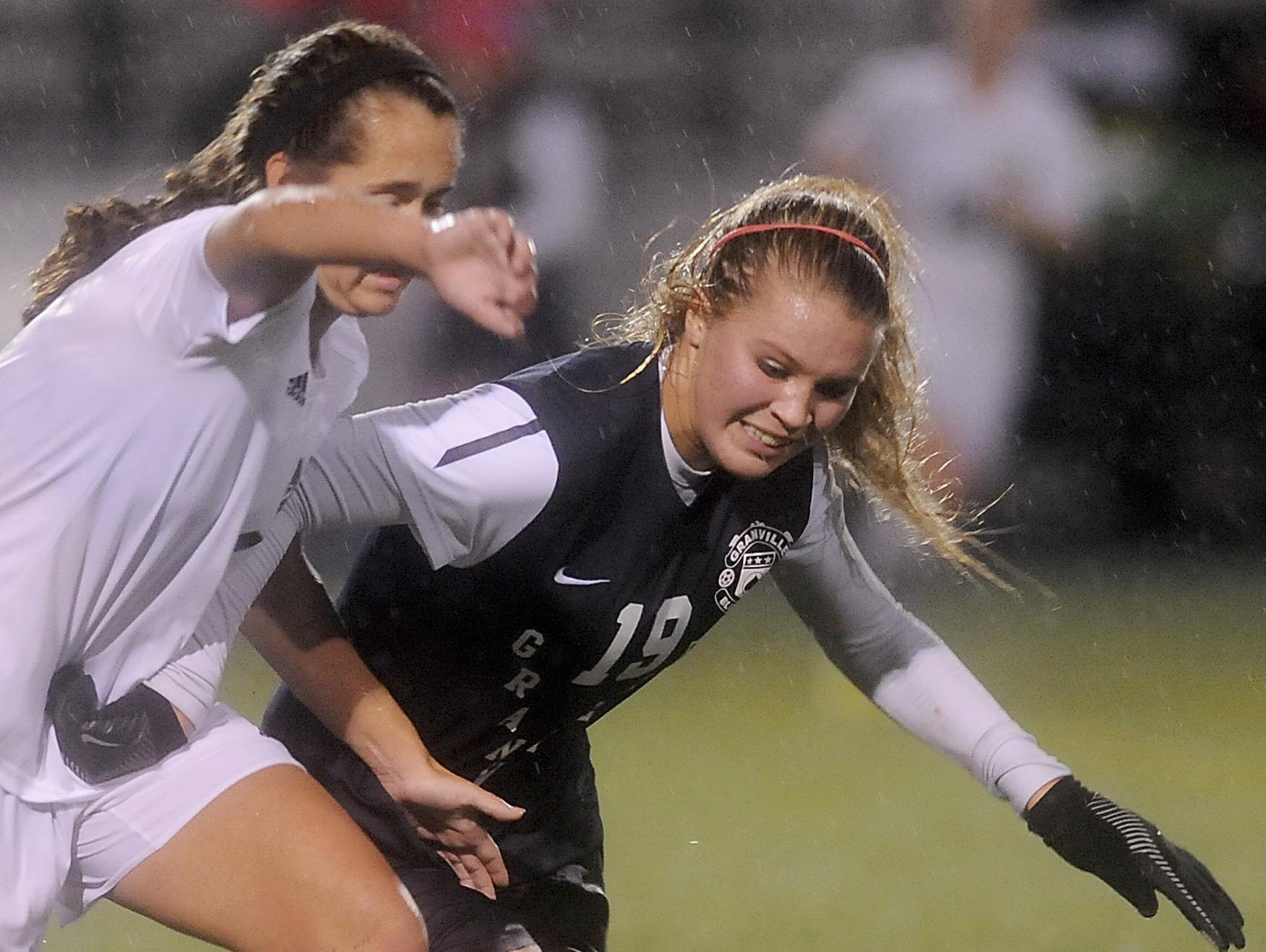 Granville midfielder Nikki Cox tries to get around McNicholas defender Michaela Shepherd during the Division II state semifinal game at West Carrollton High School last November. The Blue Aces lost to the Rockets 3-1.