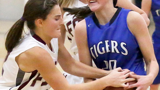 Savannah Duciaume of Fox Valley Lutheran goes for the steal from Danielle Nennig of Wrightstown in a North Eastern Conference girls basketball game on Tuesday in Appleton.