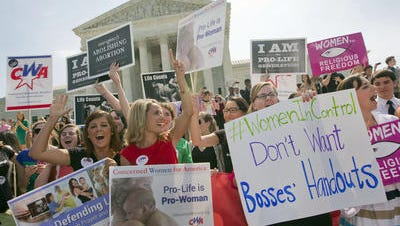 Activists outside the Supreme Court protesting the Hobby Lobby decision