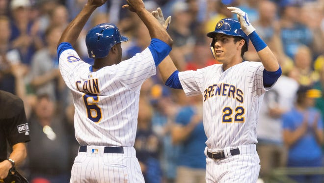 Jun 15, 2018; Milwaukee, WI, USA; Milwaukee Brewers right fielder Christian Yelich (22) is greeted by center fielder Lorenzo Cain (6) after hitting a home run during the fourth inning against the Philadelphia Phillies at Miller Park. Mandatory Credit: Jeff Hanisch-USA TODAY Sports
