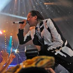 Win Butler of Arcade Fire performs with the band at The Roundhouse In London on Nov. 11, 2013.