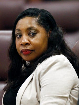 Heidelberg Elementary School Principal Lowanda Tyler-Jones, center, looks on at the Mississippi Capitol in Jackson during a hearing before the state teacher licensure commission, Monday, May 23, 2016. The commission will examine whether Tyler-Jones helped orchestrate cheating on state standardized tests in 2013 for third-grade students. The board is seeking to suspend or revoke her license.
