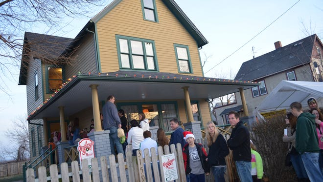 Crowds gather outside the Cleveland home used in the filming of the 1983 movie, 'A Christmas Story.'