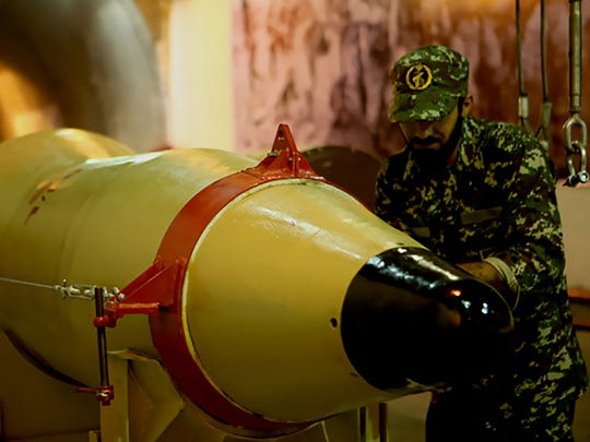 A handout picture released on March 8, 2016 by Sepah News, the online news site and public relations arm of Iran's Islamic Revolutionary Guard, shows a member of the Revolutionary Guards next to a missile launcher in an underground tunnel at an undisclosed location in Iran.