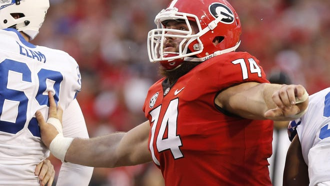 Georgia offensive lineman Ben Cleveland (74) blocks in the first half of a NCAA college football game between Georgia and Kentucky in Athens, Ga., Saturday, Nov. 18, 2017.