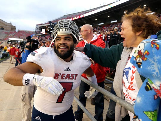 Brookfield East's Sam Santiago-Lloyd celebrates the Spartans' 42-36 win over Monona Grove in the Division 2 state title game in 2016. Santiago-Lloyd, who rushed for a state record five touchdowns in the game, was our All-Suburban Player of the Year in 2015 and 2016.