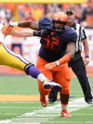 Sep 26, 2015; Syracuse, NY, USA; Syracuse Orange nose tackle Kayton Samuels (52) rushes the quarterback during the first quarter in a game against the LSU Tigers at the Carrier Dome. Mandatory Credit: Mark Konezny-USA TODAY Sports