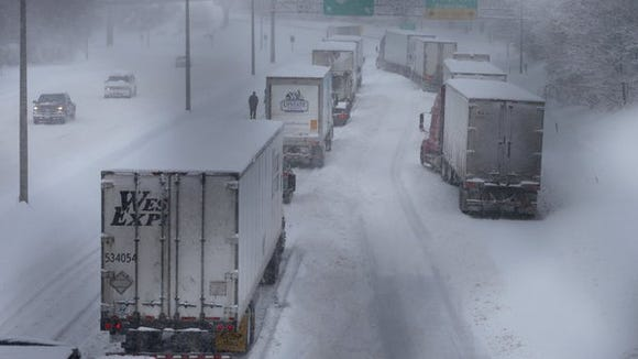 Tractor-trailers were at a standstill on Interstate 490 westbound, just east of the Douglass-Anthony Bridge in downtown Rochester, around 2:50 p.m. Tuesday.