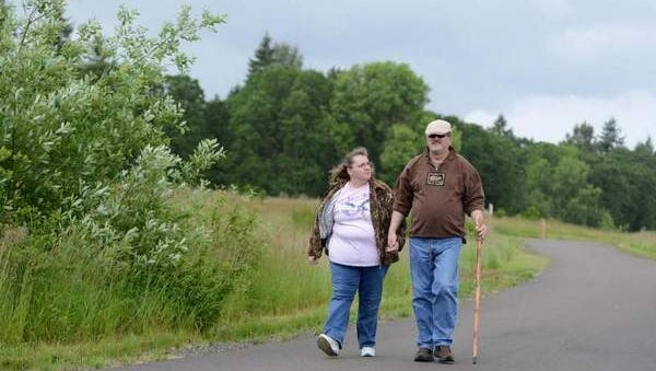 Wayne and Connie Bruce of Wilsonville go for a walk at Graham Oaks Nature Park.