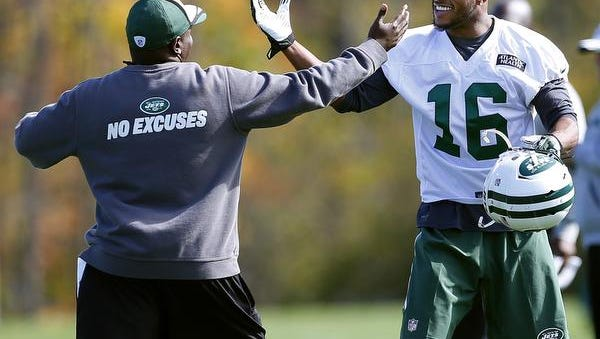 Jets wide receiver Percy Harvin is greeted by assistant strength-and-conditioning coach Aaron McLaurin, left, at practice in Florham Park, N.J., Monday, Oct. 20, 2014.