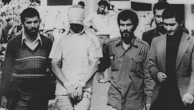 One of 60 American hostages is displayed to the crowd outside the American embassy in Tehran on Nov. 9, 1979.
