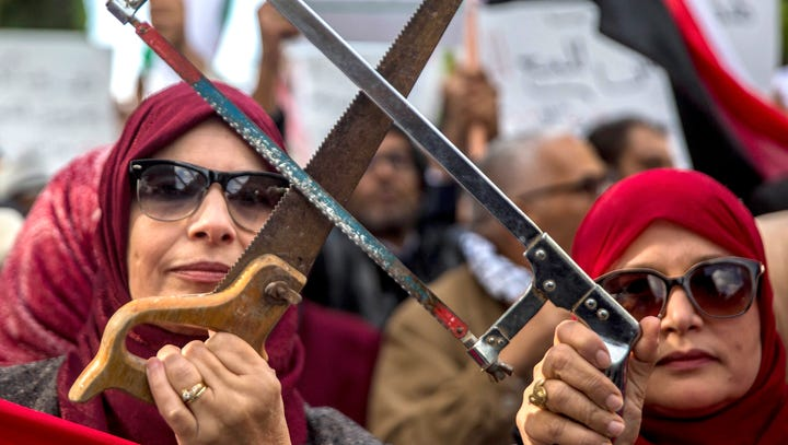 People demonstrate with saws Tuesday Nov. 27, 2018