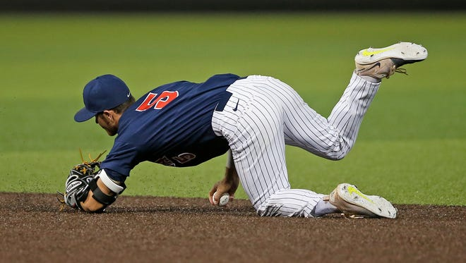 Arizona's Louis Boyd (5) slides while fielding a ground ball during the team's NCAA college baseball tournament regional game against Sam Houston State, Friday, June 2, 2017, in Lubbock, Texas. (Brad Tollefson/Lubbock Avalanche-Journal via AP)