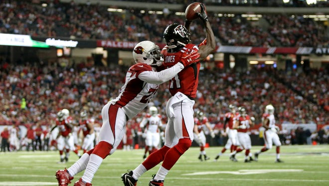 Atlanta Falcons wide receiver Julio Jones makes a catch against Arizona Cardinals cornerback Patrick Peterson in the second quarter of their game at the Georgia Dome on Sunday, Nov. 30, 2014.