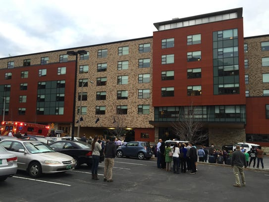 Guests and workers from Hotel Vermont gather in the