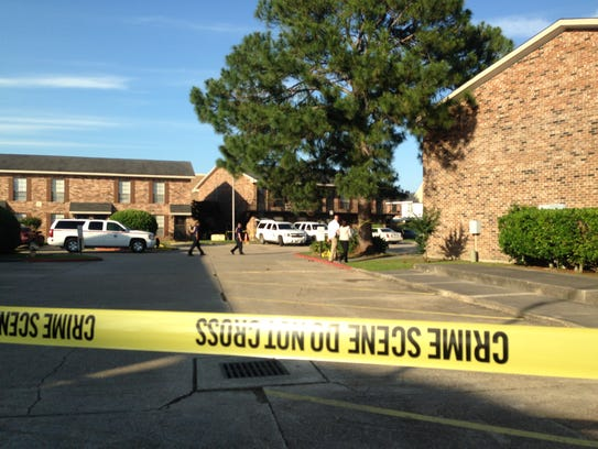 Police tape blocks part of Bell Downs Apartments Tuesday