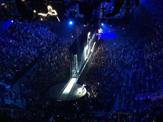 Bono appears in person and on screen at Tuesday's U2