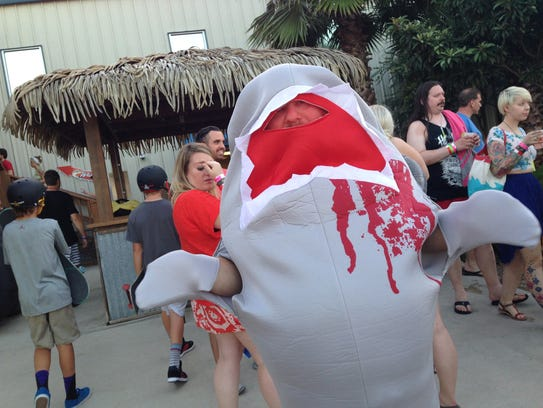 A moviegoer in a shark costume attends Saturday night's