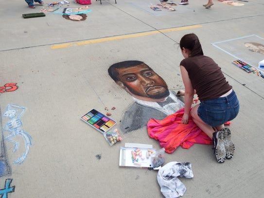 Kate Goodvin, a freshman at City High, draws a portrait