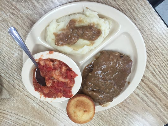 Country fried steak, stewed tomatoes and mashed potatoes