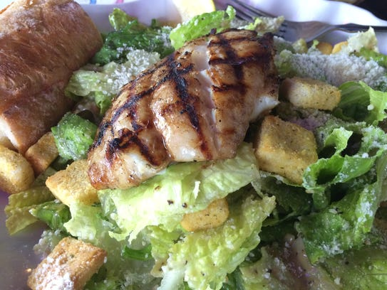 A Caesar salad topped with chargrilled grouper from
