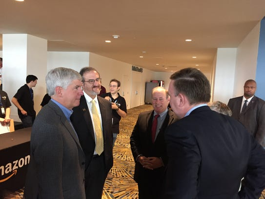 Gov. Rick Snyder (left) chats with University of Michigan