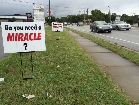 Signs up in front of Victory Christian Center, 1641