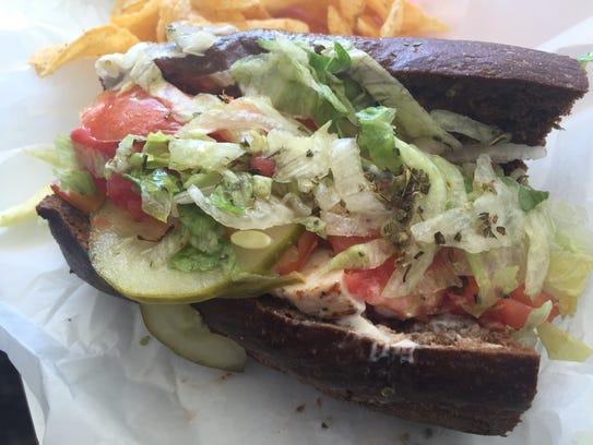 Southwest chicken sandwich served on a rye submarine