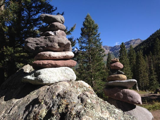 Stone-stackers leave their mark along Bear Creek Trail,
