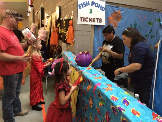 Kids fish for fun at one of the popular game booths