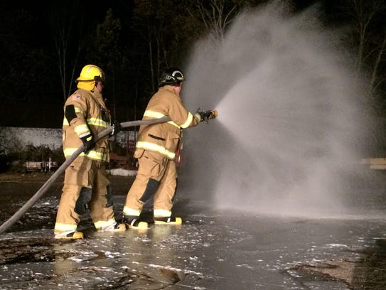 Two firefighters from Door County spend their class
