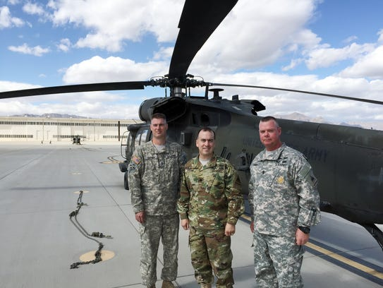 From left, Chief Warrant Officer 3 (promotable) Justin