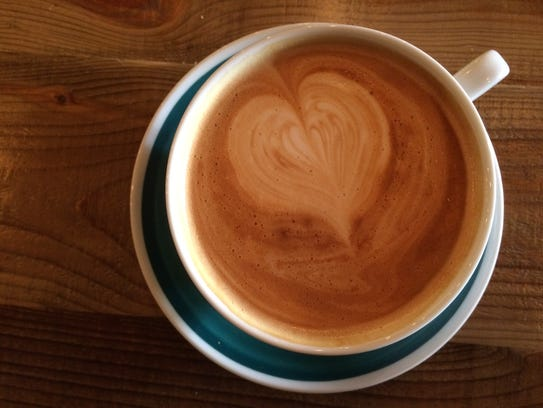 Cardamom clove latte is a popular coffee drink at Timshel