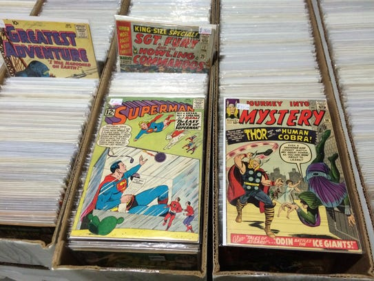Vintage issues of Thor and Superman are displayed at