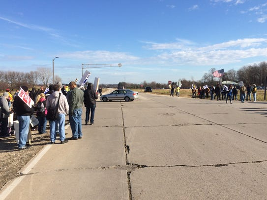 UAW Local 833 members and their supporters block a