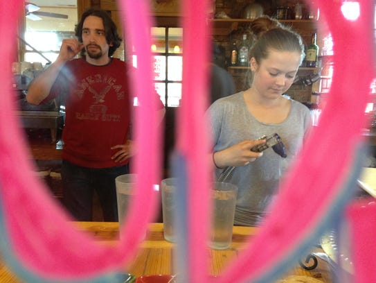 Tim Evans, a line cook, and Danielle Twilley, a waitress,
