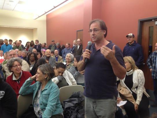 Carey Hamburg of Lafayette asks a question Thursday