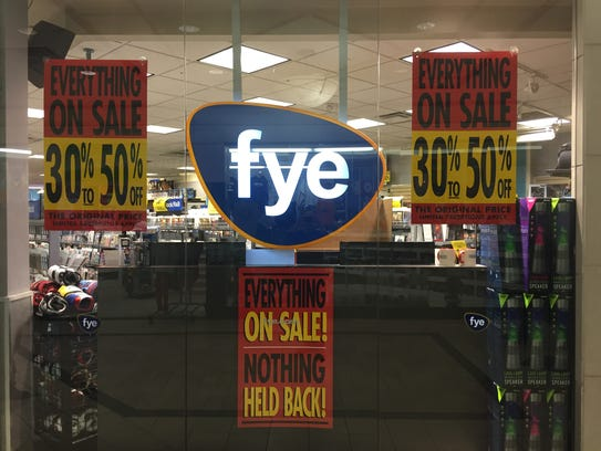 Signs announce the going-out-of-business sale at F.Y.E.