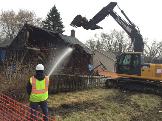 Crews tear down a blighted home behind Gompers Elementary-Middle