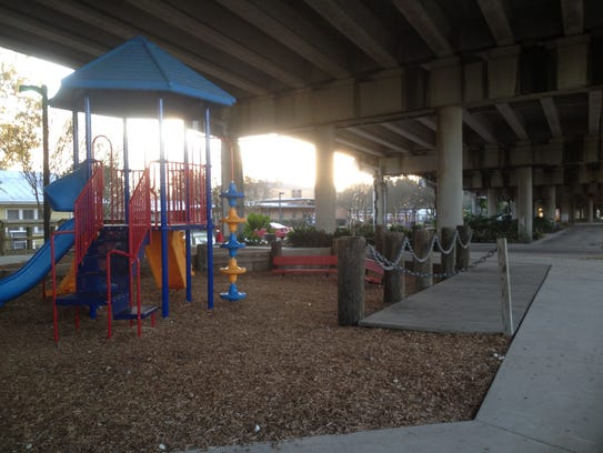 Pathways, park benches and playground equipment are