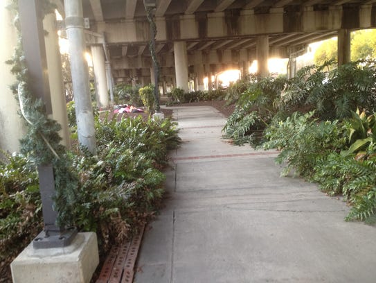Walking paths surrounded by greenery are part of a