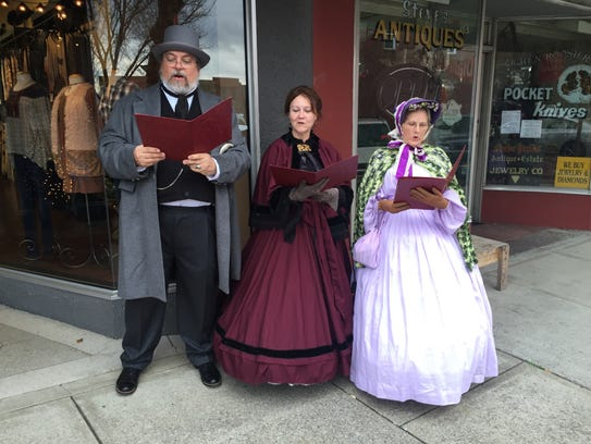 Caroling in downtown are, from left, Bobby Turman Jr.,