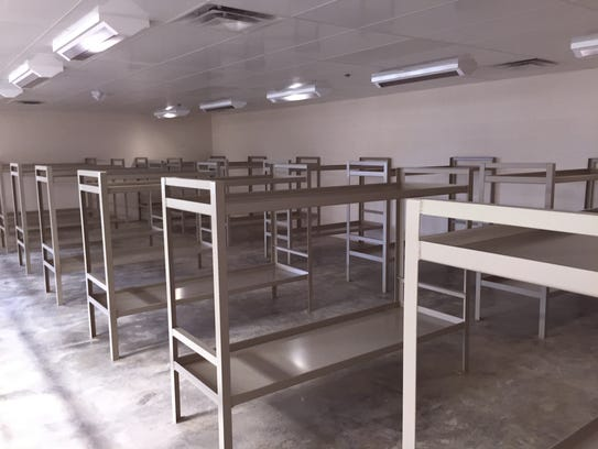 A second-floor dorm area features 32 bunks.