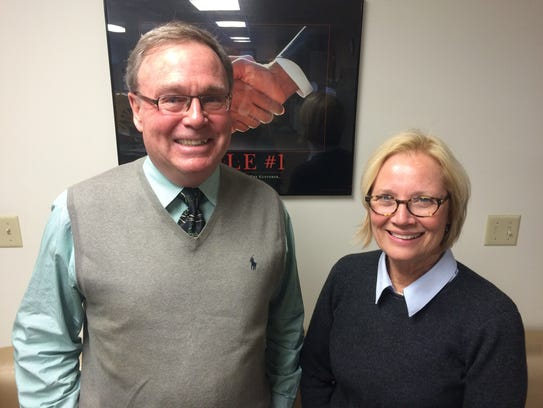Mark and Deb Hadley pose for a photo at Hadley Office
