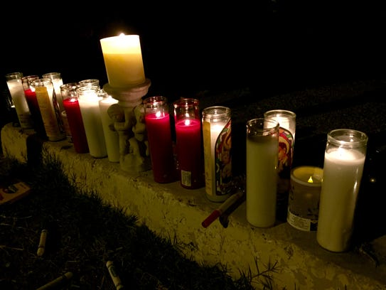 An assortment of candles were lined up outside of the