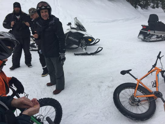 A group of snowmobile riders stop near Brockway Summit