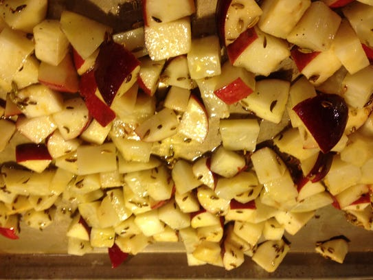Celeriac and apples tossed with canola oil and fennel